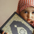 Cute-little-muslim-baby-holing-Holy-Quran